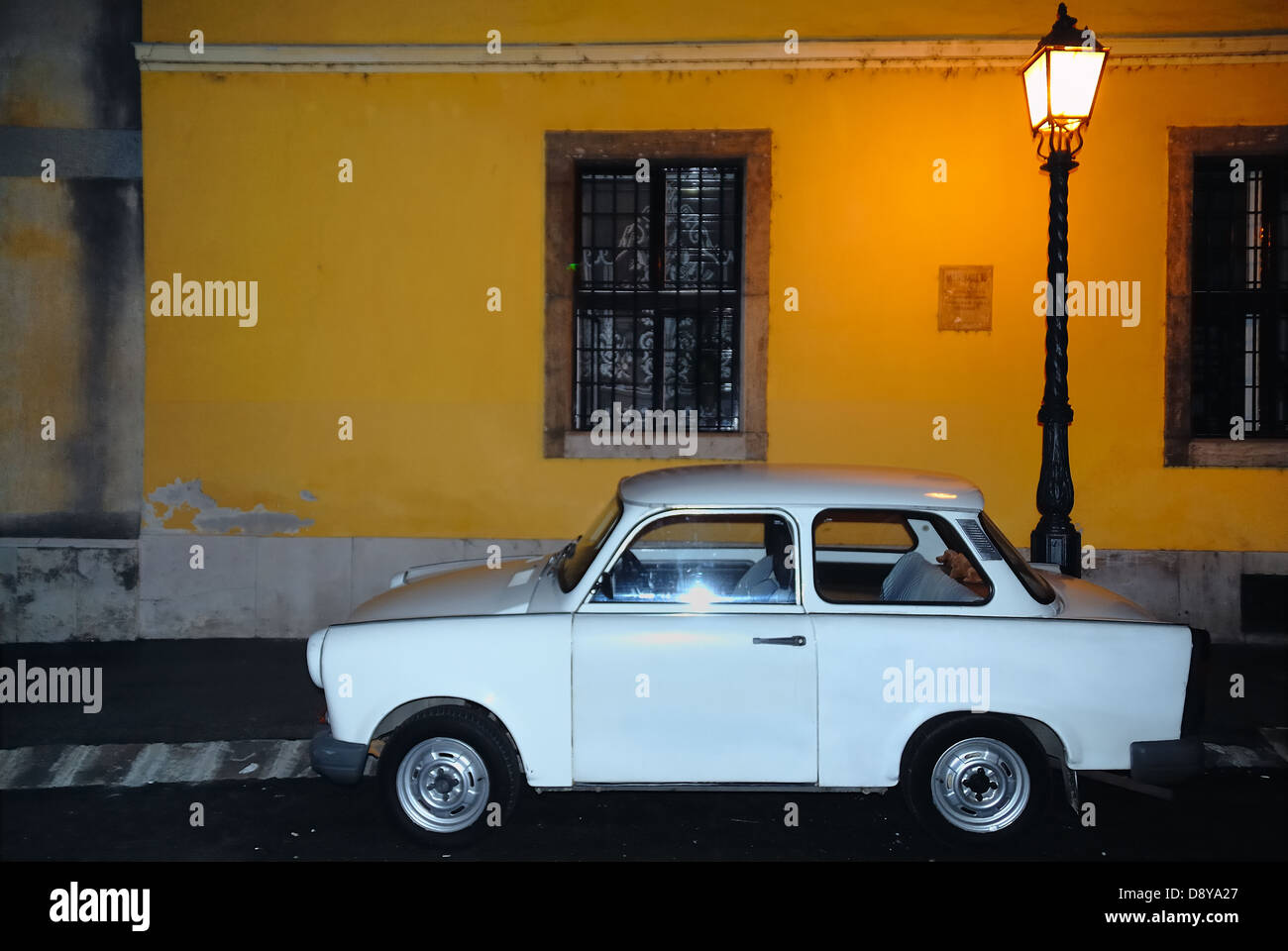 Budapest, Hungary : a Trabant car parked under a streetlight. Night. - Stock Image