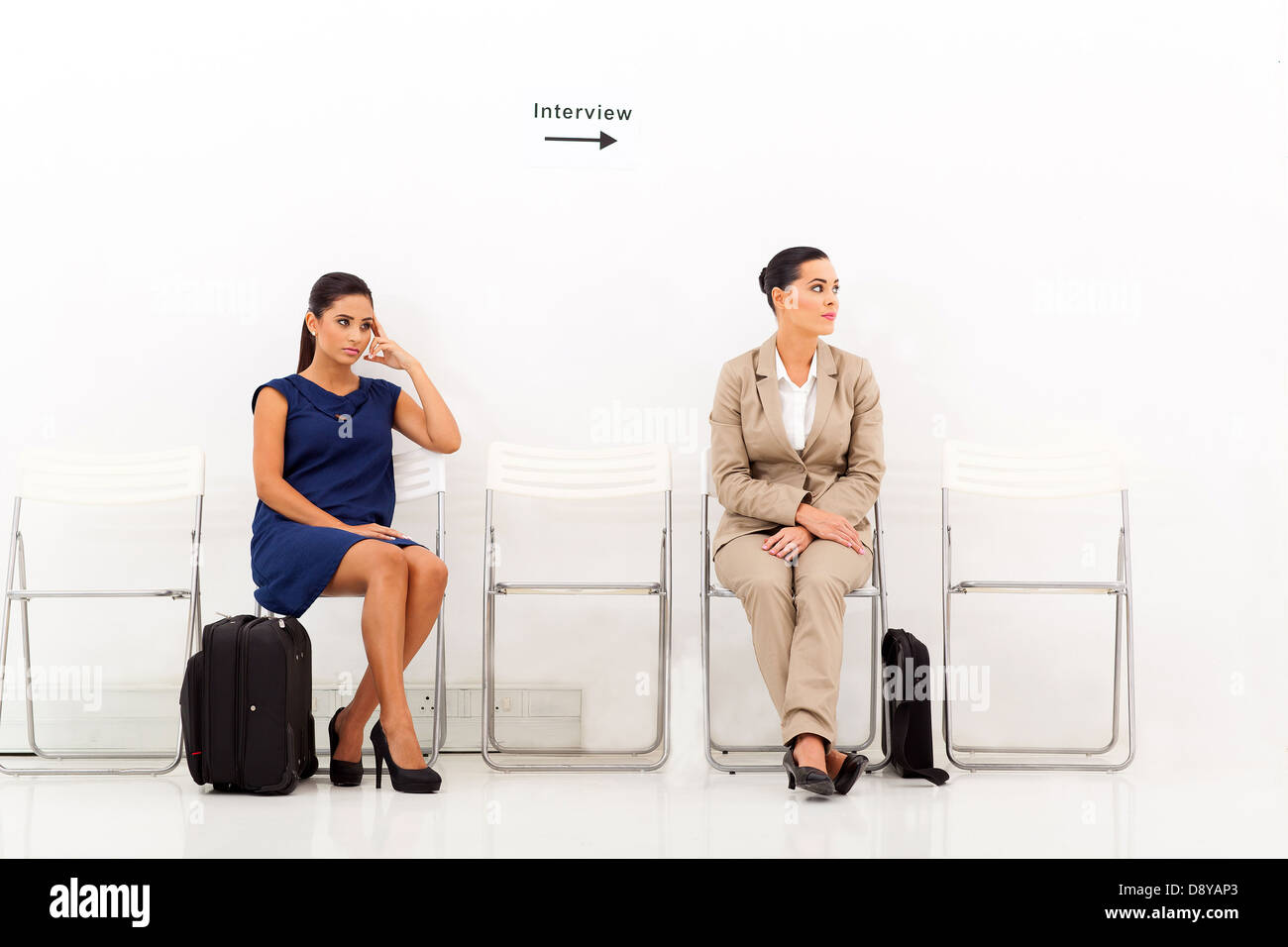 two beautiful female candidates waiting for job interview - Stock Image