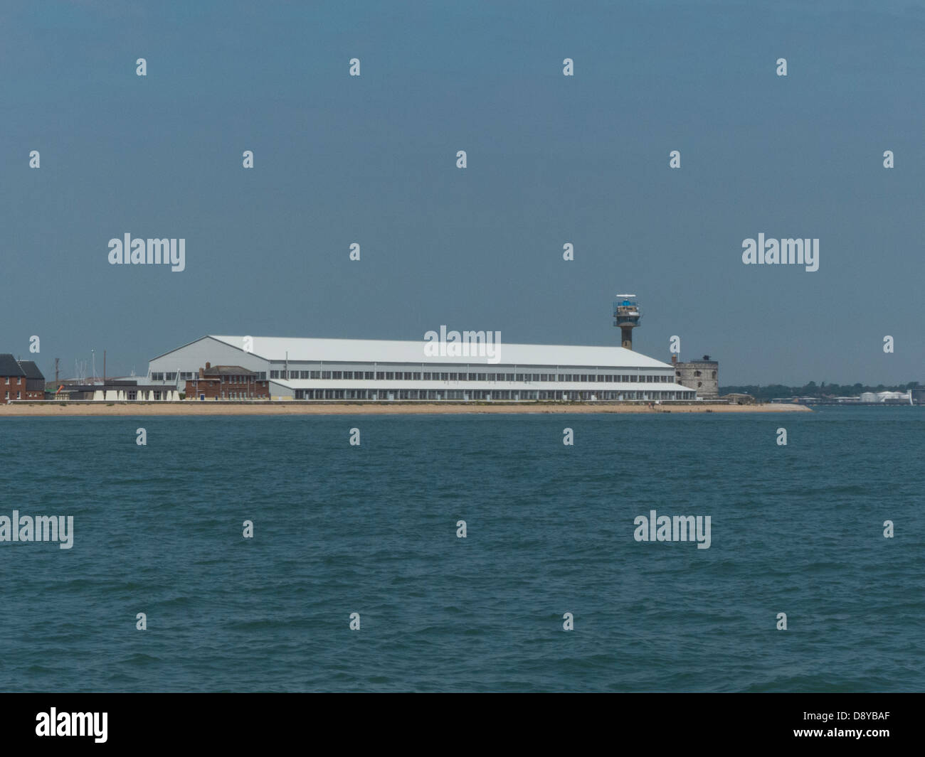 Calshot Activity Main Sports Hanger viewed from the Solent in Hampshire UK - Stock Image