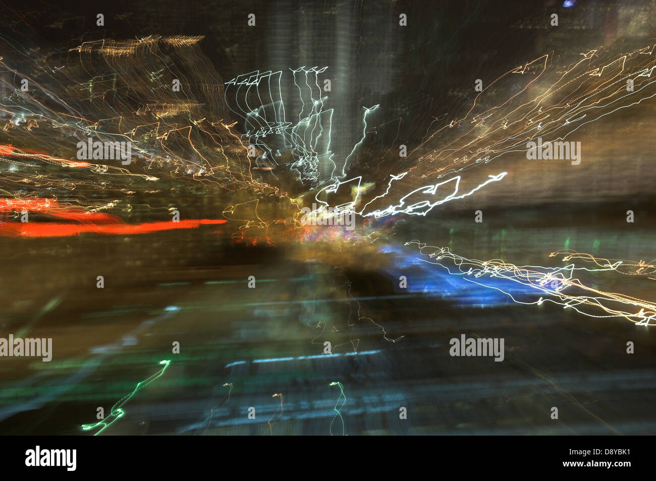 Abstract background of frenzied city lights in traffic - Stock Image