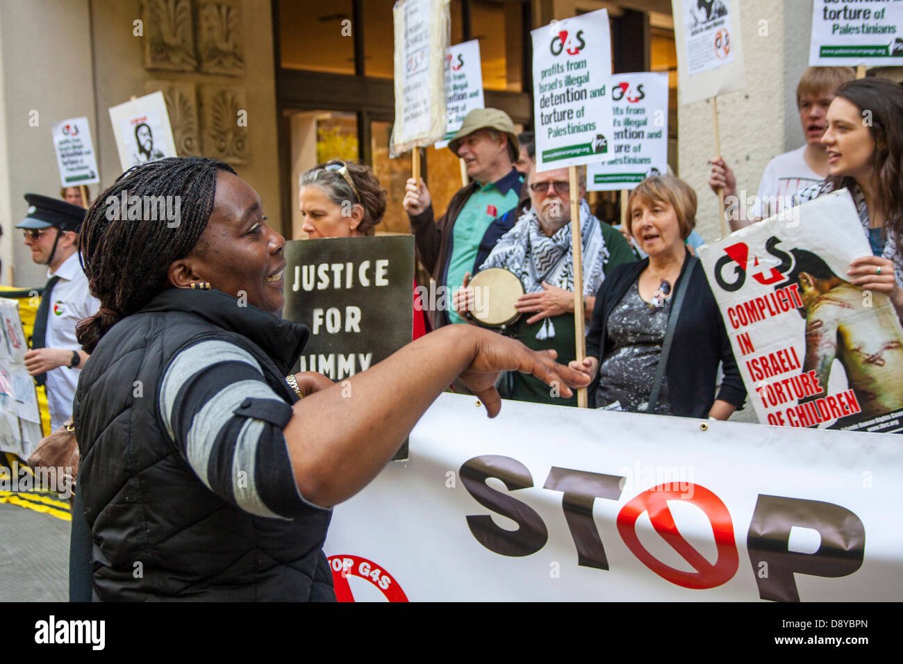 Protesters outside the AGM of security multinational G4S demonstrates against the company's involvement in Israeli - Stock Image