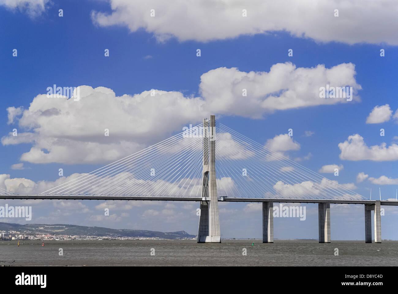 Portugal, Estremadura, Lisbon, Vasco da Gama suspension bridge over the River Tejo or Tagus seen from Parc das Nacoes. - Stock Image