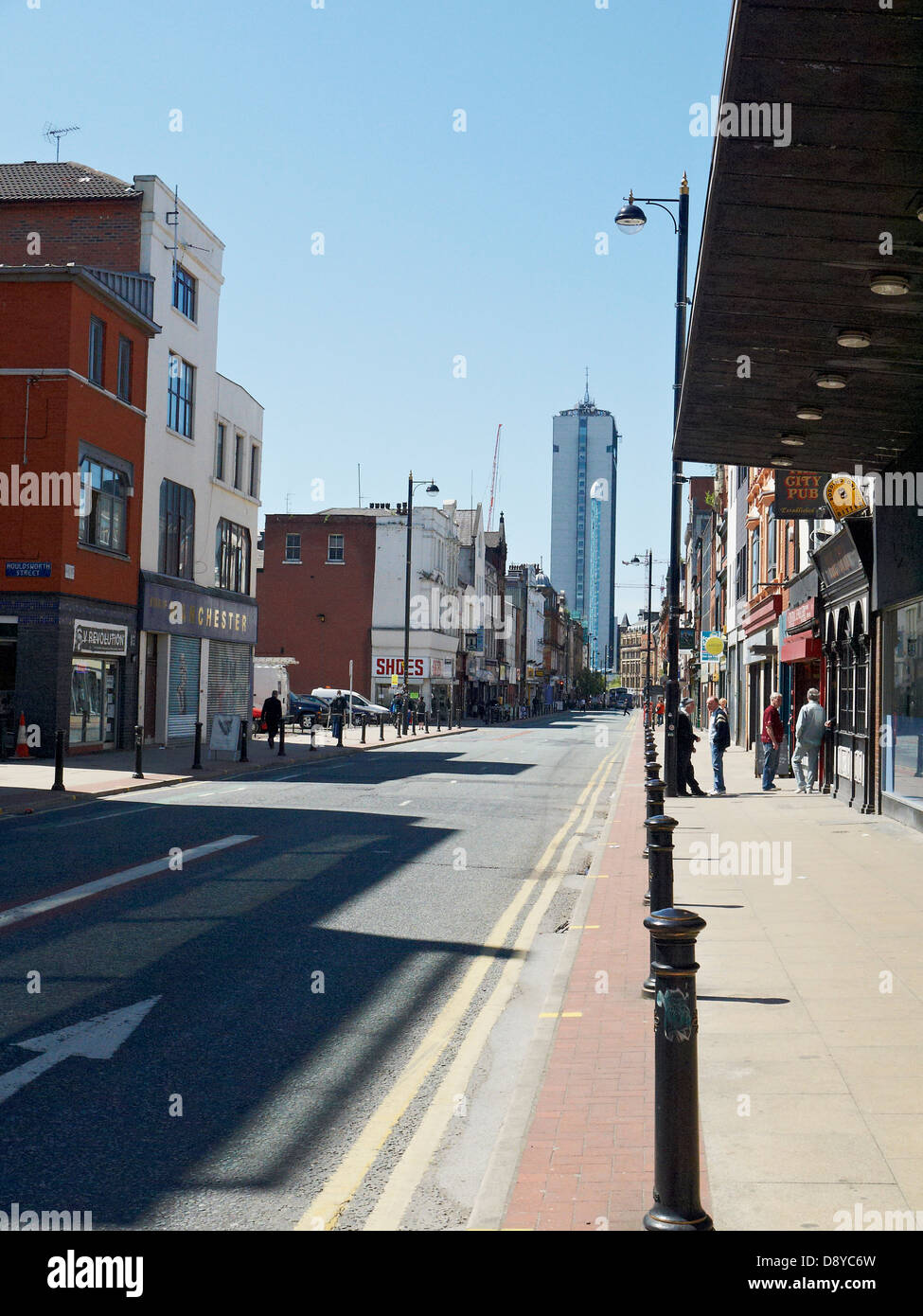 View into Oldham Street towards City Tower in Manchester UK - Stock Image