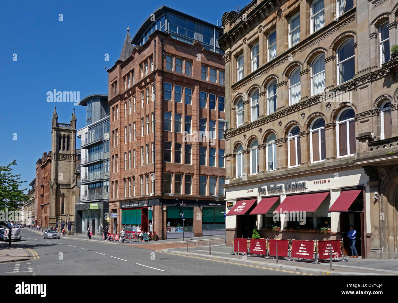 Ingram Street in the Merchant City area of Glasgow Scotland with eating places - Stock Image