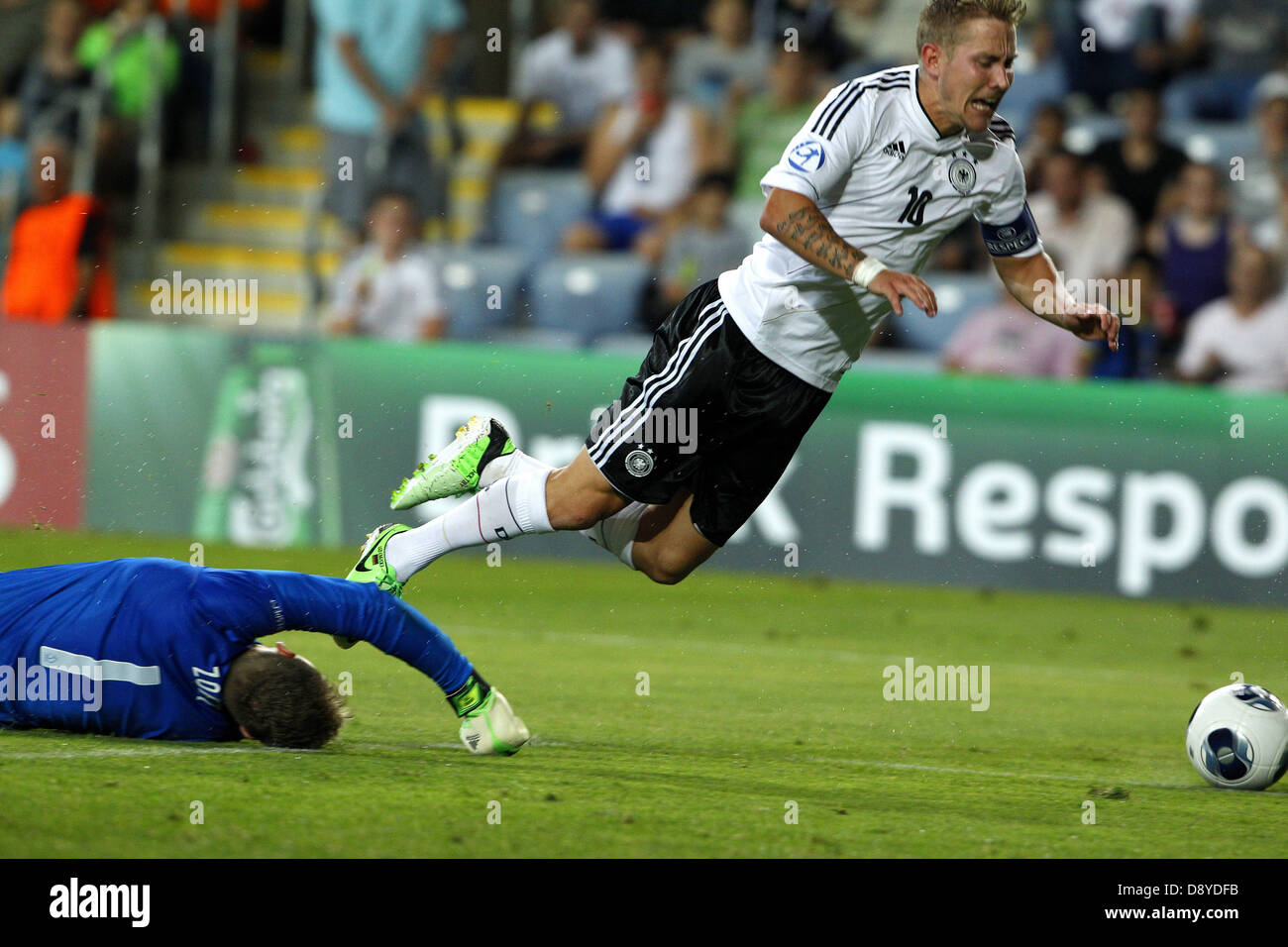Lewis Holtby (R) of Germany is tackled by goalkeeper Jeroen Zoat of The Netherlands  during the UEFA European Under - Stock Image