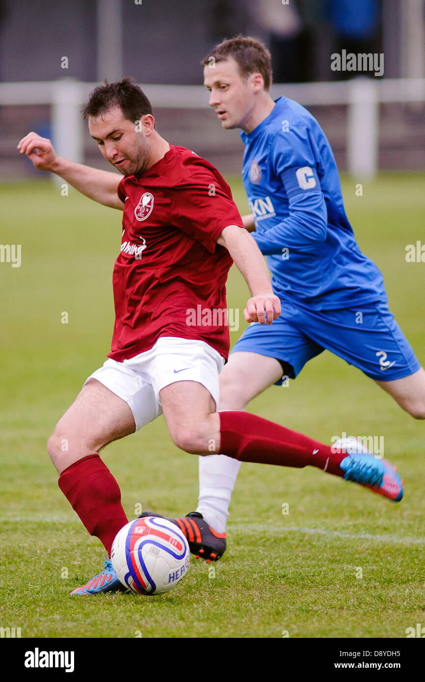 Kelty, Fife, Scotland, UK. 5th June 2013. Damon Gray shoots during the East Region Super league match, Kelty v Lochee - Stock Image
