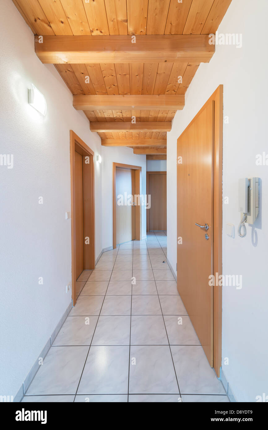 White tiled corridor in an appartment - Stock Image