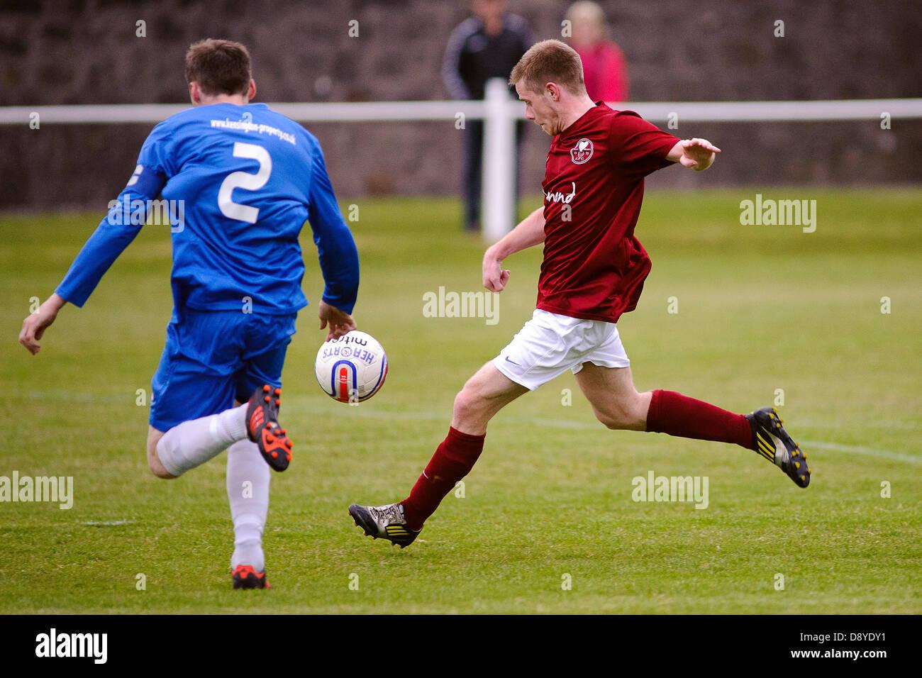 Kelty, Fife, Scotland, UK. 5th June 2013. Stuart Cargill shoots during the East Region Super league match, Kelty - Stock Image