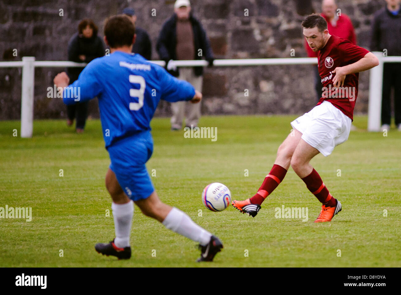 Kelty, Fife, Scotland, UK. 5th June 2013. Brian Ritchie shoots during the East Region Super league match, Kelty - Stock Image