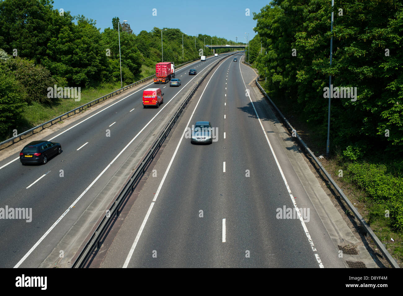 A12 Essex, UK. Vehicles using the outside lane on dual carriageway when no traffic is in nearside lane. - Stock Image