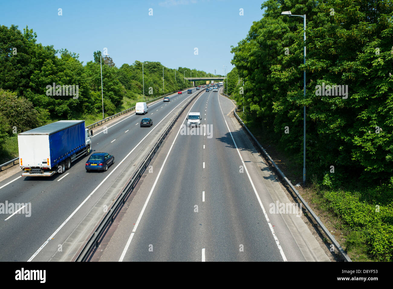 A12 Essex, UK. Vehicles using the outside lane on dual carriageway when no traffic is in nearside lane. Stock Photo