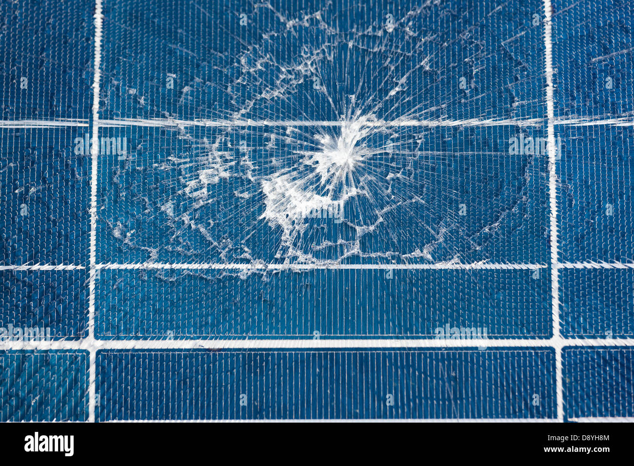 Damaged Chinese Solar Panel broken due to impact. Shattered cracked burst glass close up. Import imported from, - Stock Image