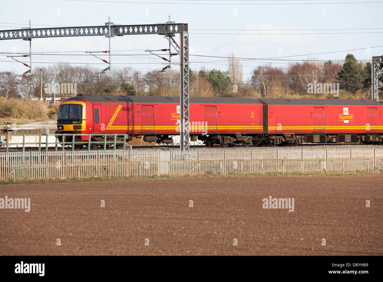 A Royal Mail train on the electrified West Coast Main Line railway in Staffordshire. - Stock Image