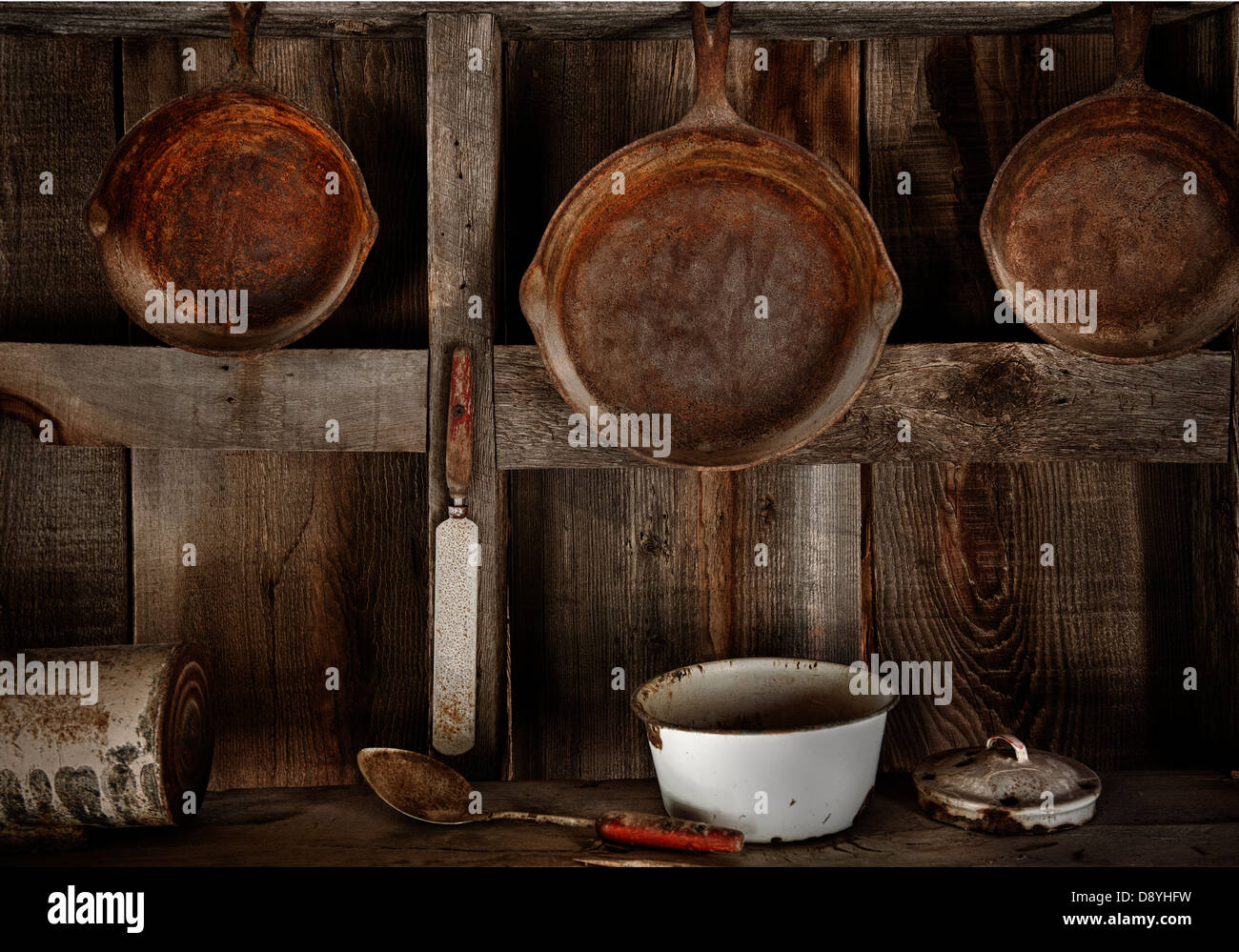 a kitchen utensils vignette featuring a symmetrical composition and desert patina. - Stock Image