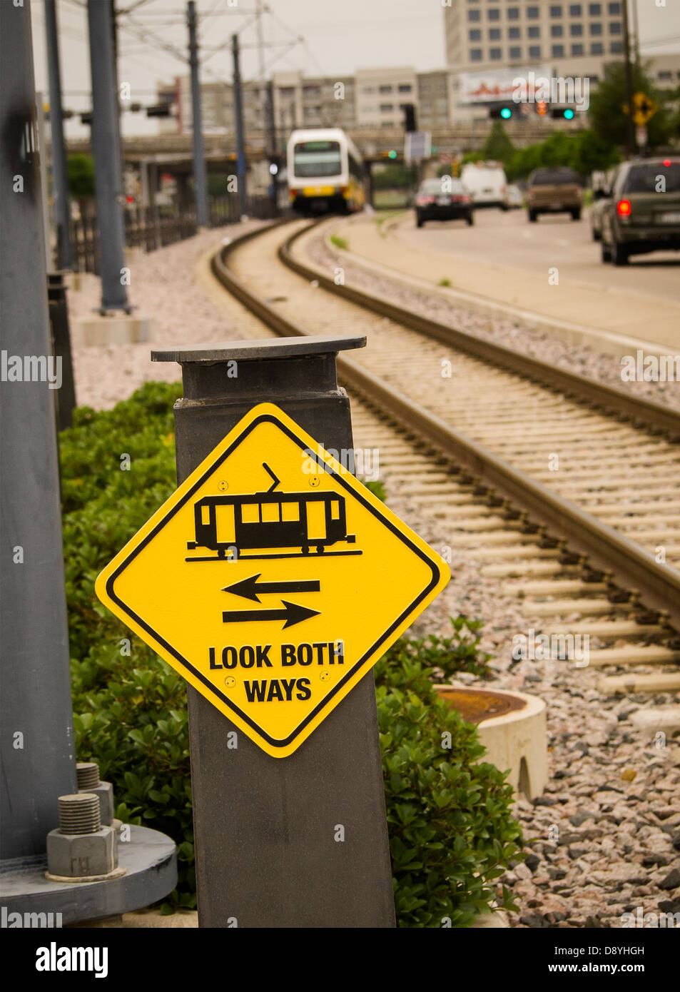 Mass transit comes to Dallas, Dallas Area Rapid Transit, electric street cars. Safety sign warns pedestrians to - Stock Image