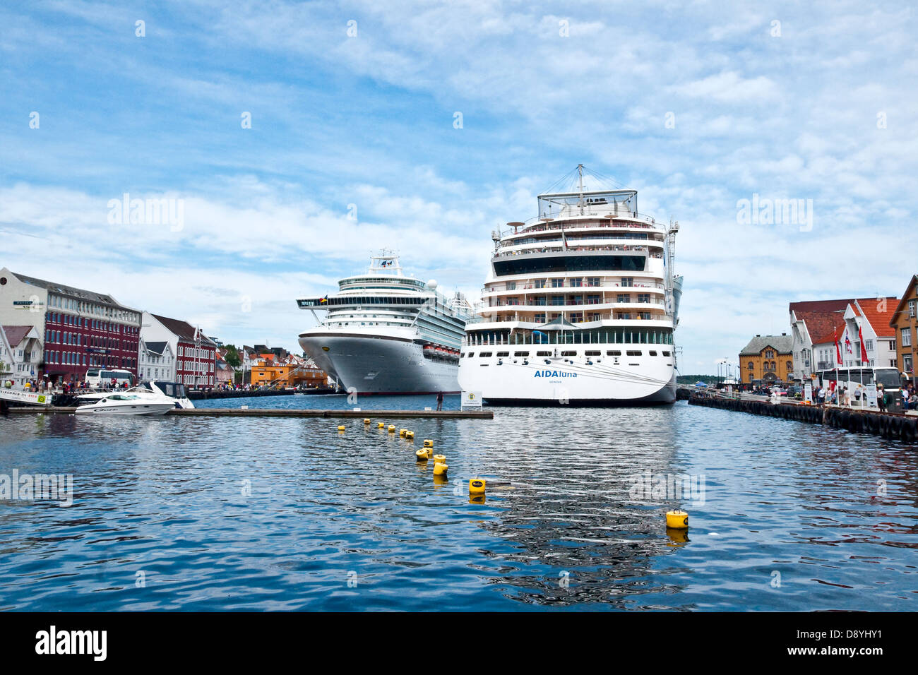 Cruise ships visiting the Norwegian city of Stavanger are able to moor right in the middle of the old town - Stock Image