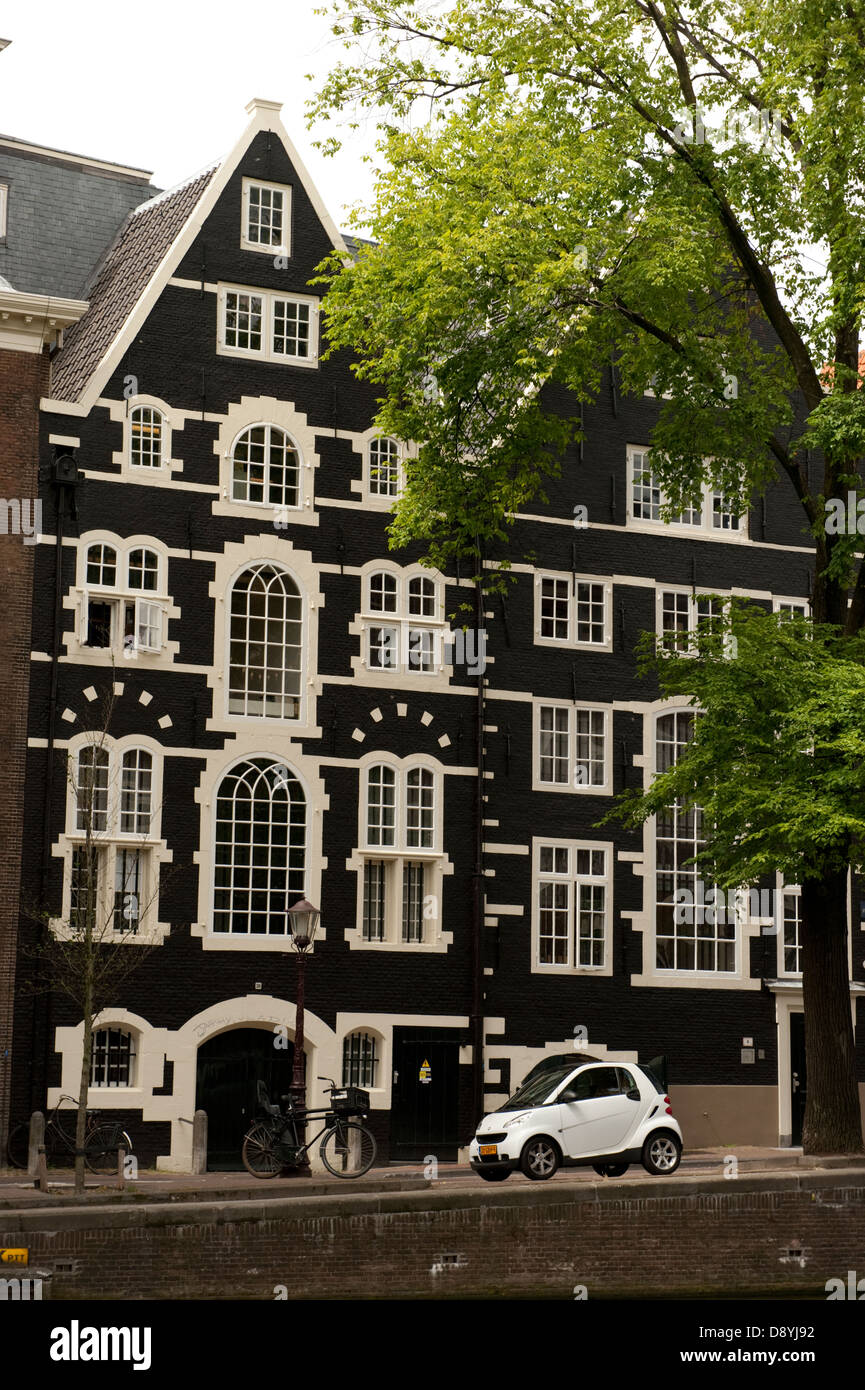 Very old traditional houses tall narrow Amsterdam Holland Netherlands Europe - Stock Image