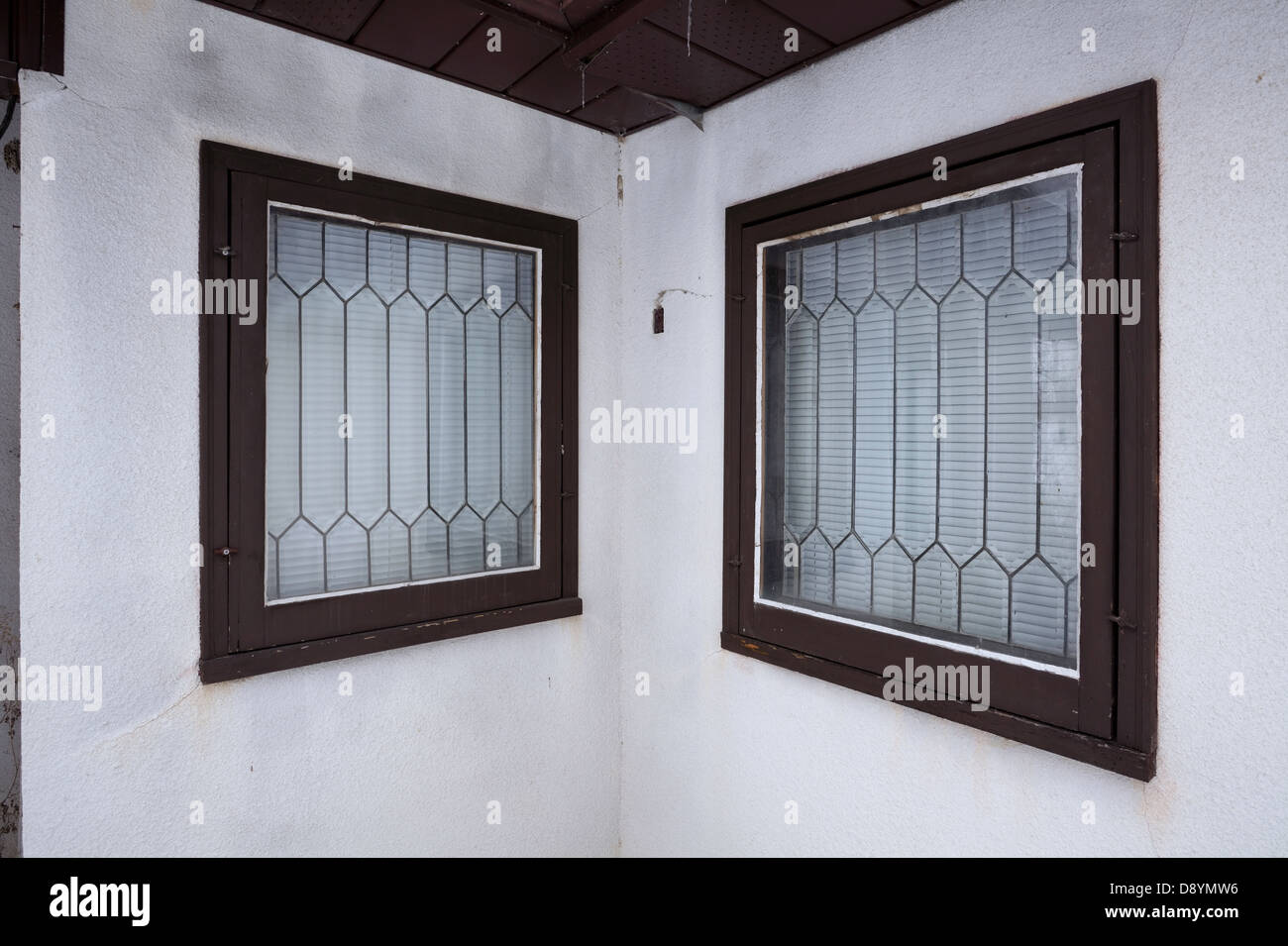 Lead glass windows in an old abandoned house. - Stock Image