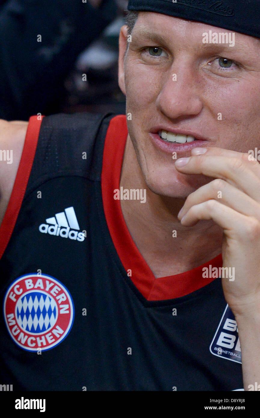 Professional soccer player of Bundesliga club FC Bayern Munich, Bastian Schweinsteiger, follows the Bundesliga Basketball - Stock Image