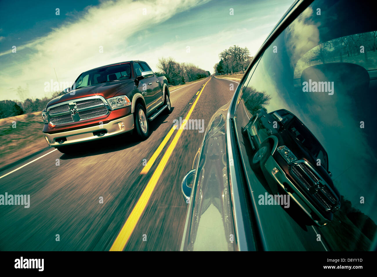 Dodge Ram  1500 Laramie Longhorn  pick up truck driving on a ranch road in Texas USA - Stock Image