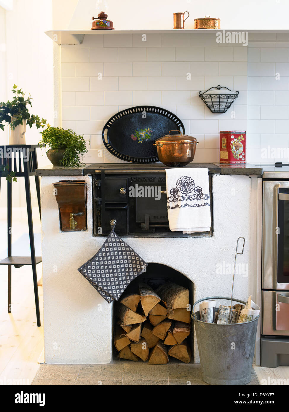 An old fashioned wood stove in a kitchen. - Stock Image