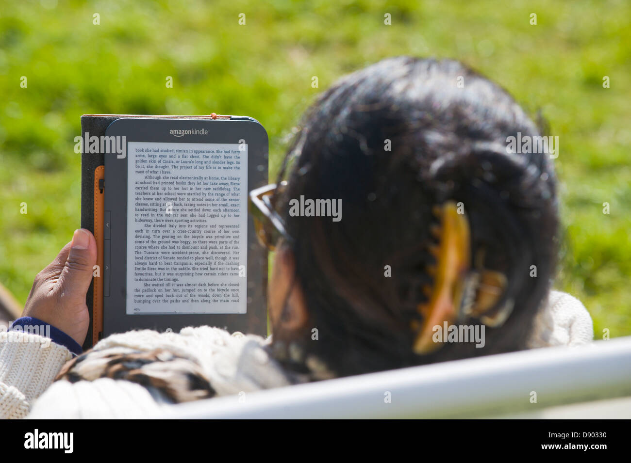 Woman Reading Amazon Kindle Book Outside At Hay Festival