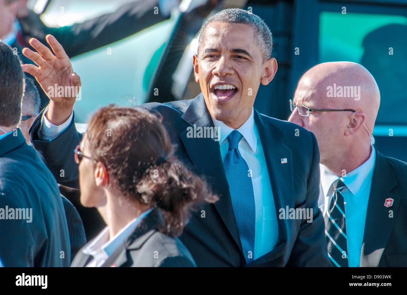 US President Barack Obama waves to the public after arriving at Moffett Federal Airfield on Air Force One June 6, - Stock Image