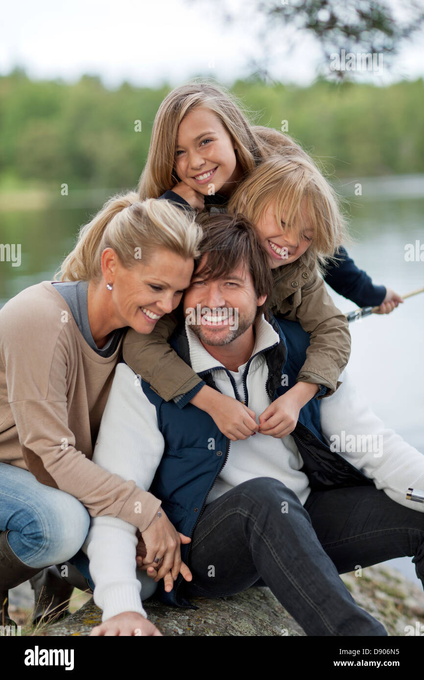 Parents and two children bonding Stock Photo