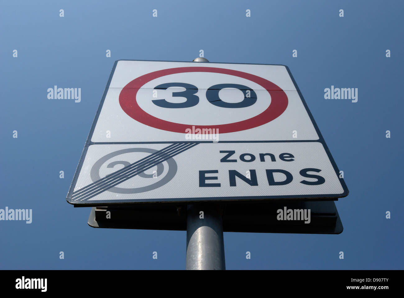 british road sign indicating end of 20mph zone and start of 30mph zone Stock Photo