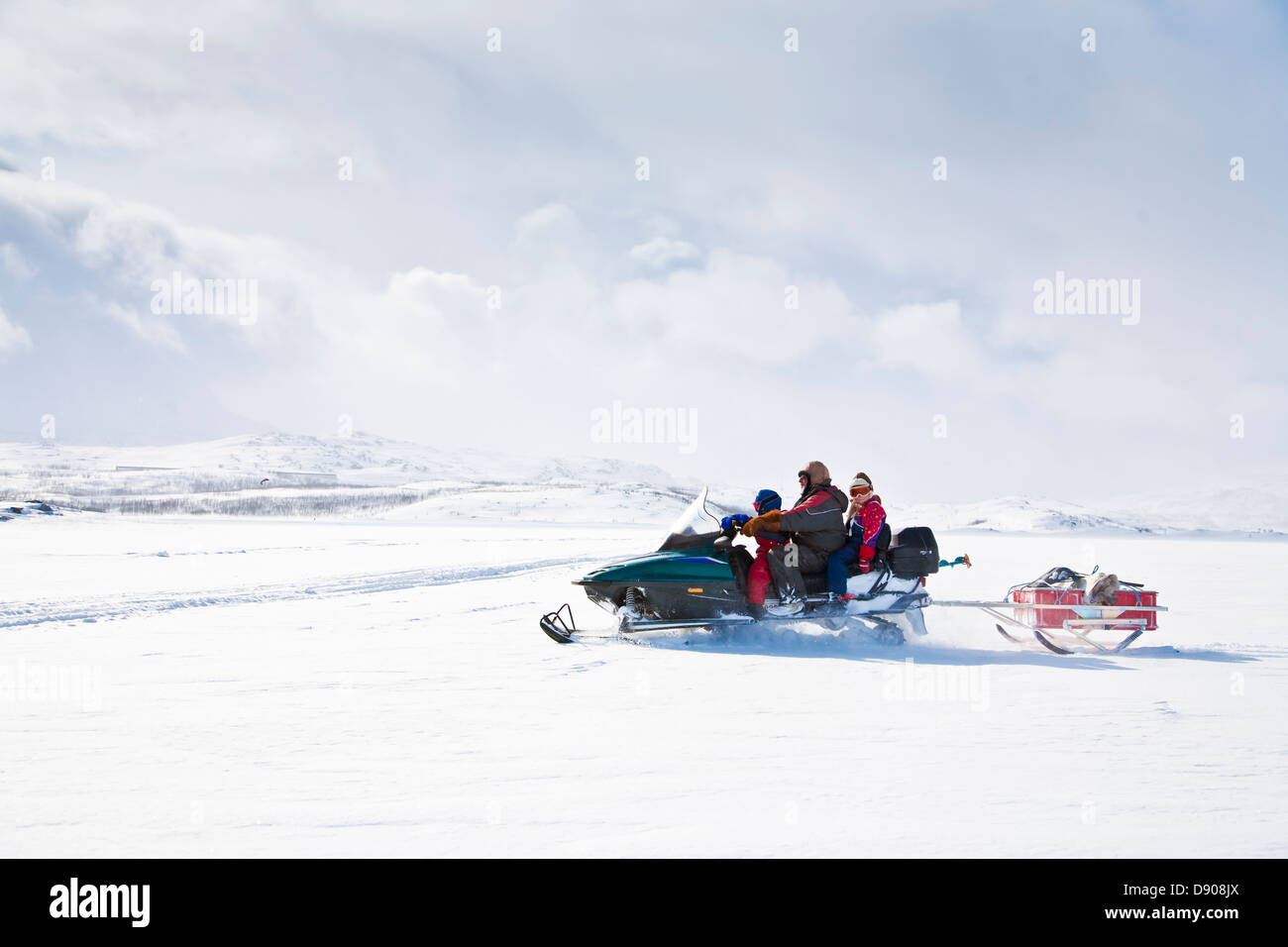 Family on snowmobile - Stock Image