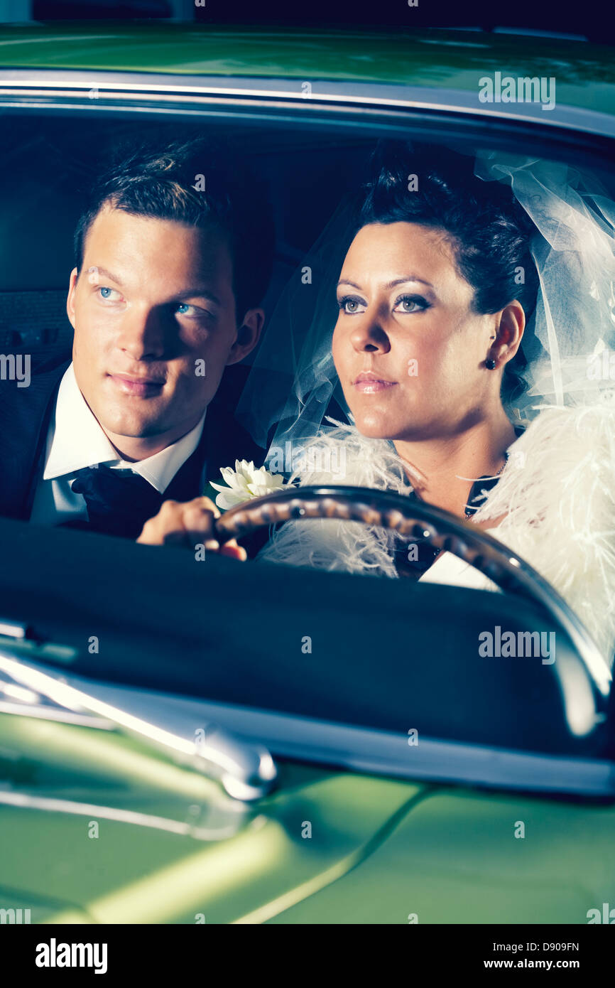 A bridal couple in a sports car, Sweden. - Stock Image