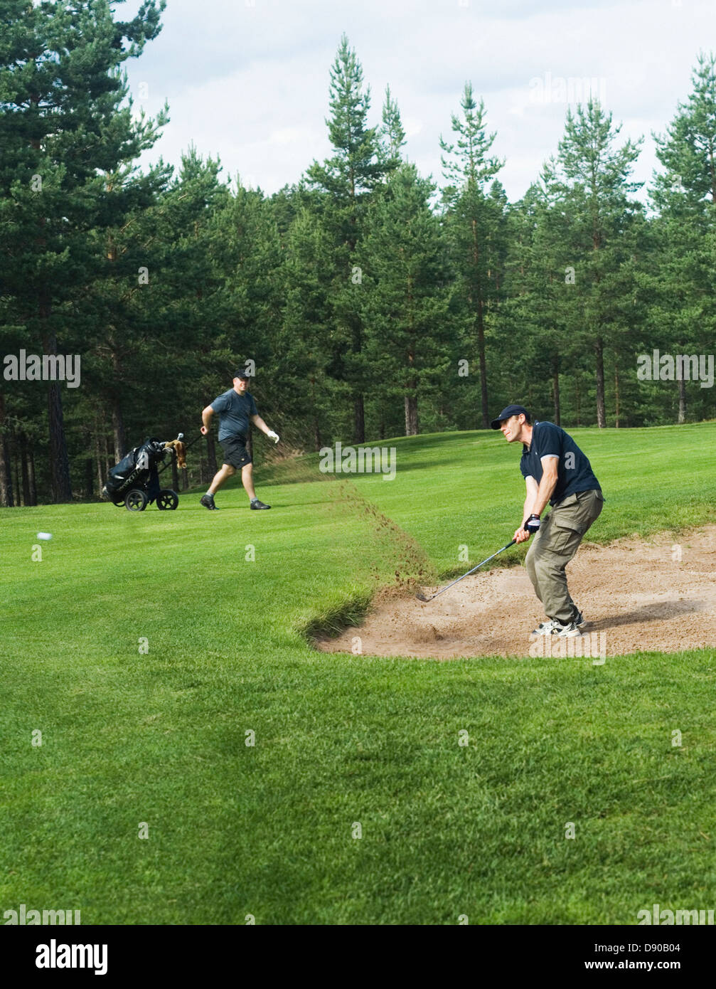A man playing golf in Dalarnan Sweden. - Stock Image