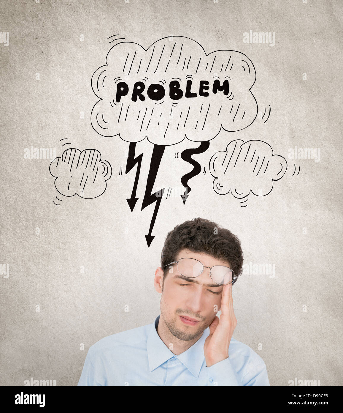 Concept image of handsome young businessman, who has a problem with lot of working tasks to solve and he is overloaded. - Stock Image
