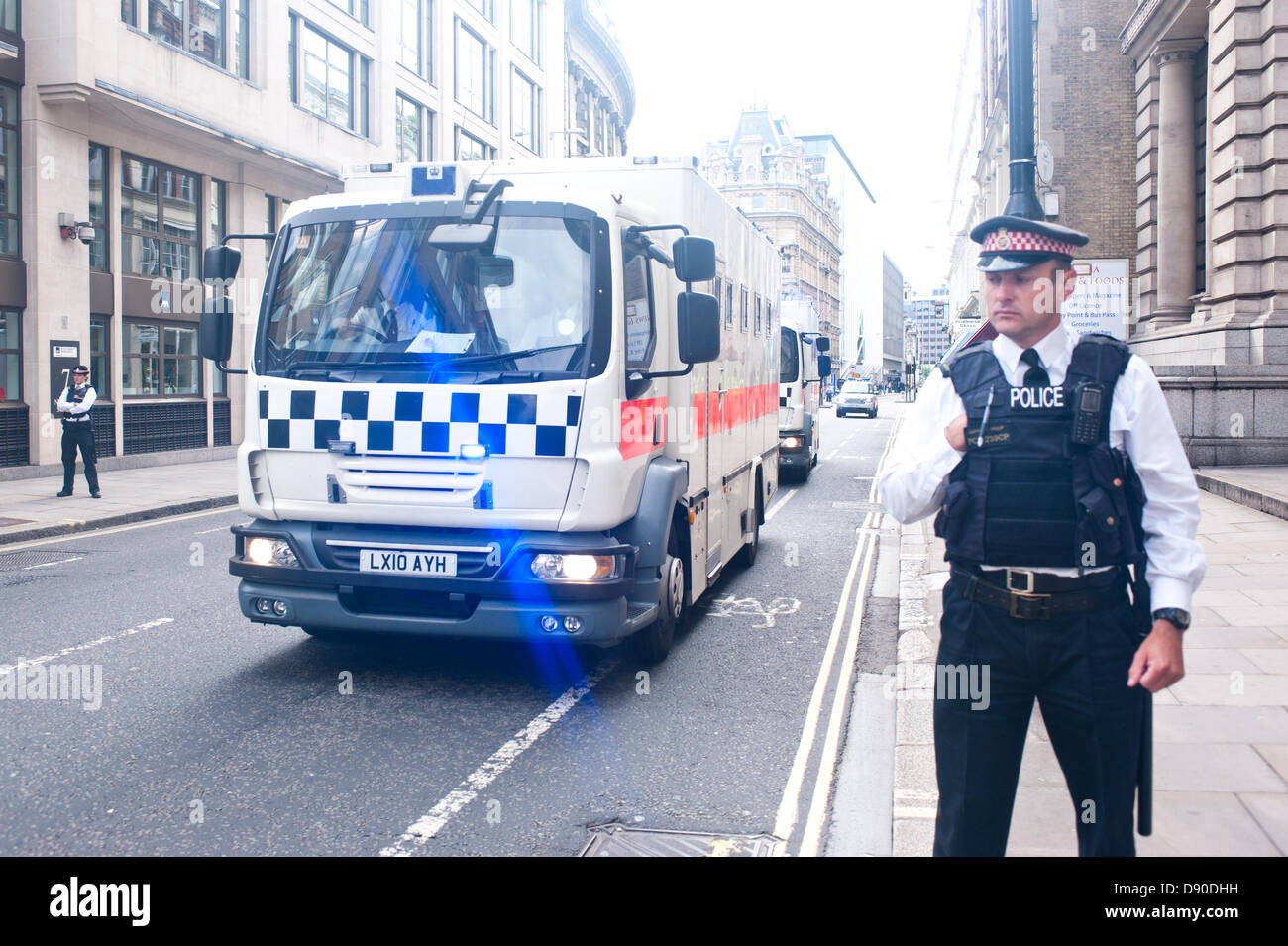 London, UK - 7 June 2013: Police vans believed to be carrying six Islamic extremists pleaded guilty to planning - Stock Image