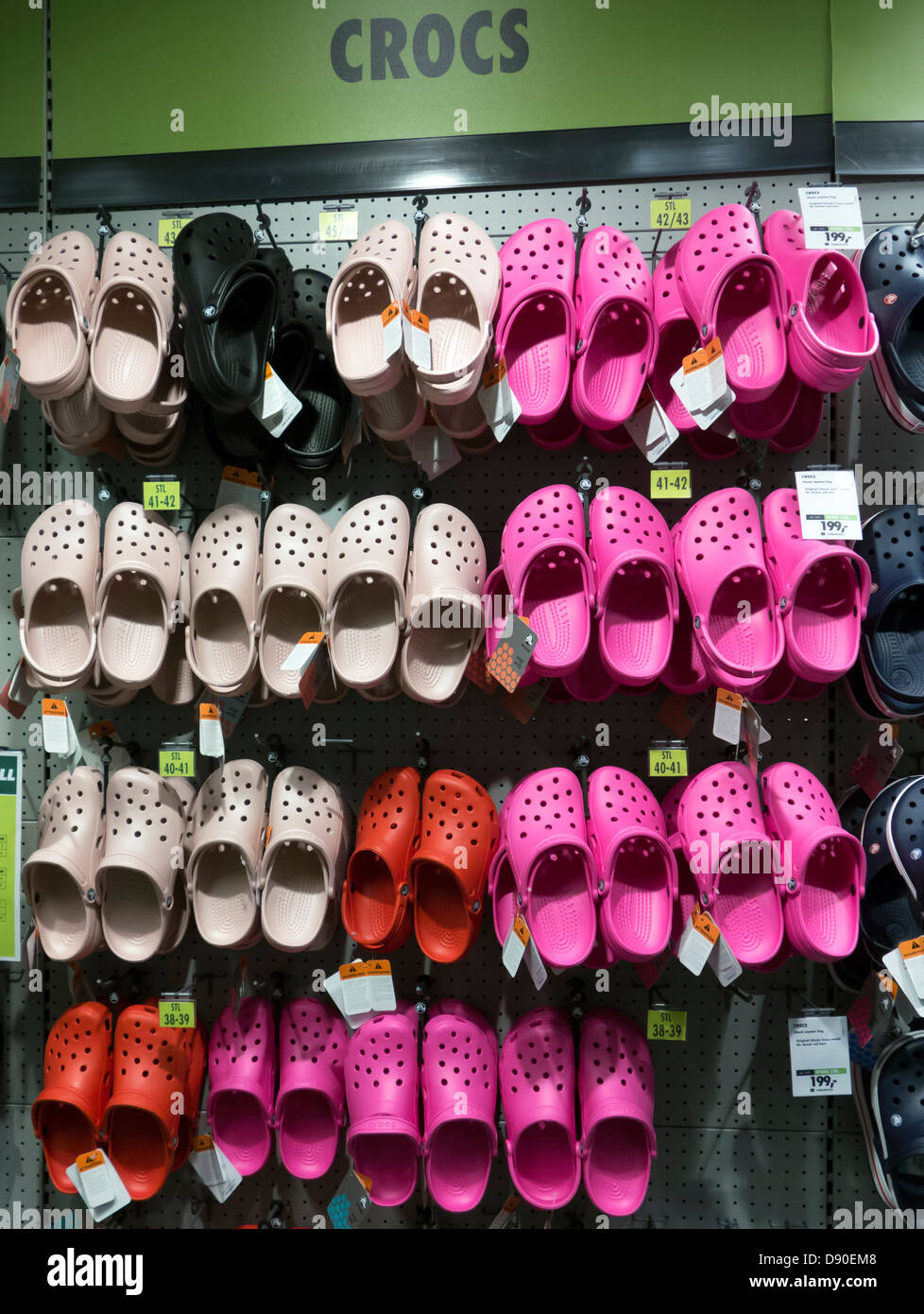 Crocs shoes on display stand in a footwear shop. - Stock Image
