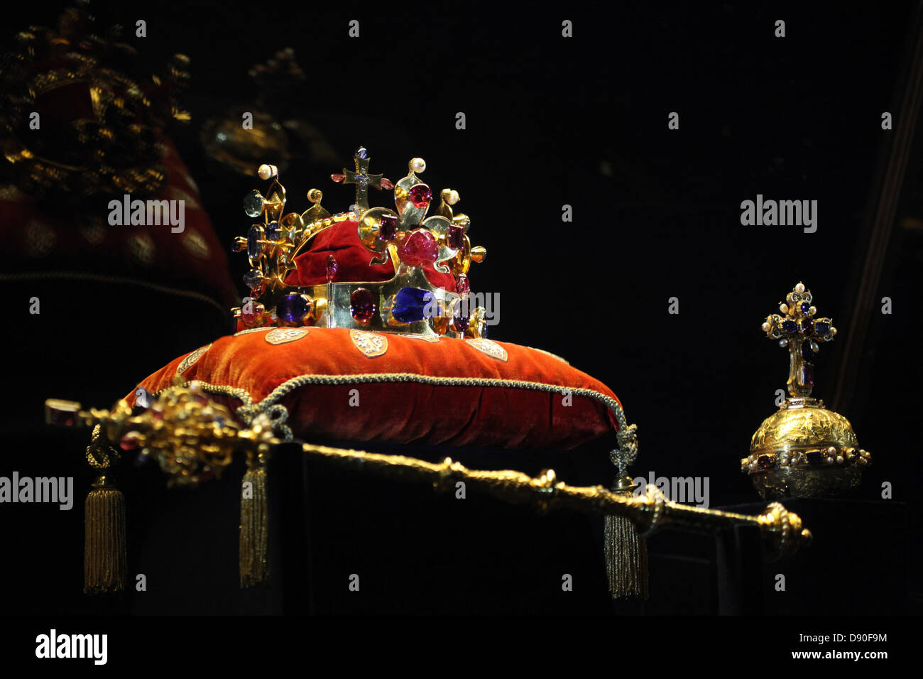 The Crown of Saint Wenceslas and the Royal Apple and Sceptre displayed at the exhibition of the Czech Crown Jewels. Stock Photo