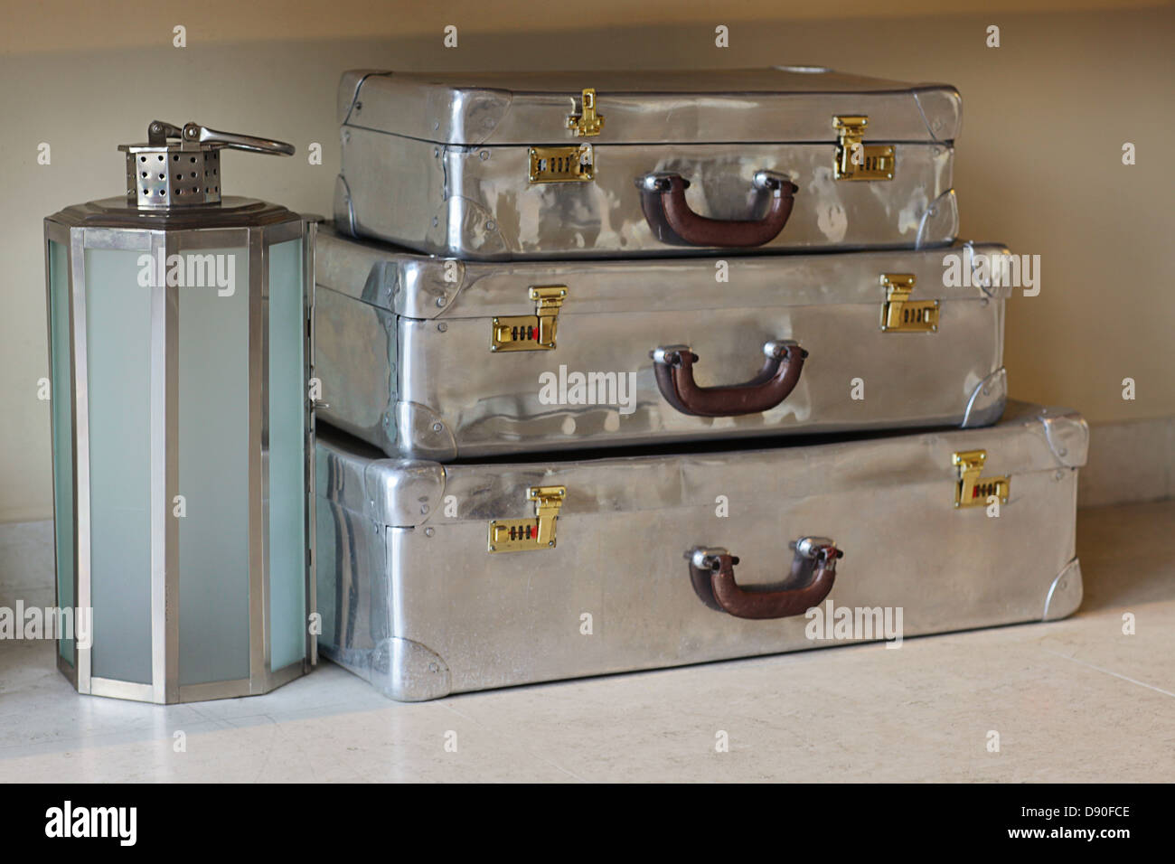 Old fashioned stainless steel suitcases for travel - Stock Image