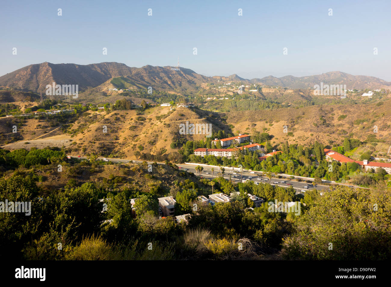 Highway 101 freeway runs through the Cahuenga Pass and the Hollywood Hills in Los Angeles Southern California USA - Stock Image
