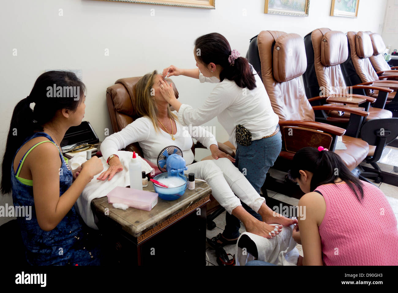 American woman gets manicure and pedicure at Vietnamese owned nail ...