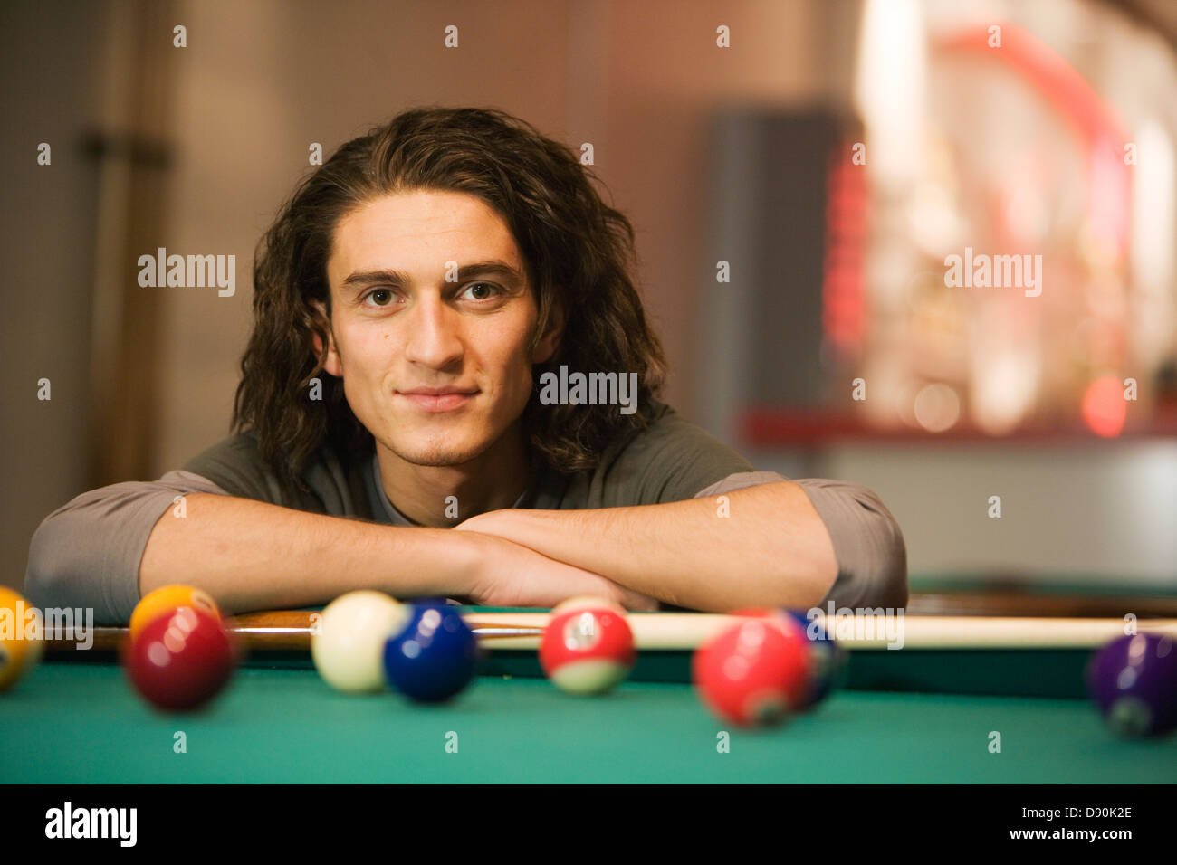 Male pool player chalking cue, close-up. - Stock Image