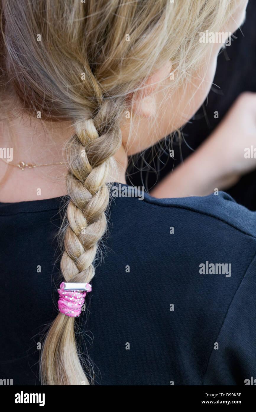 close-up of girls plaits - Stock Image