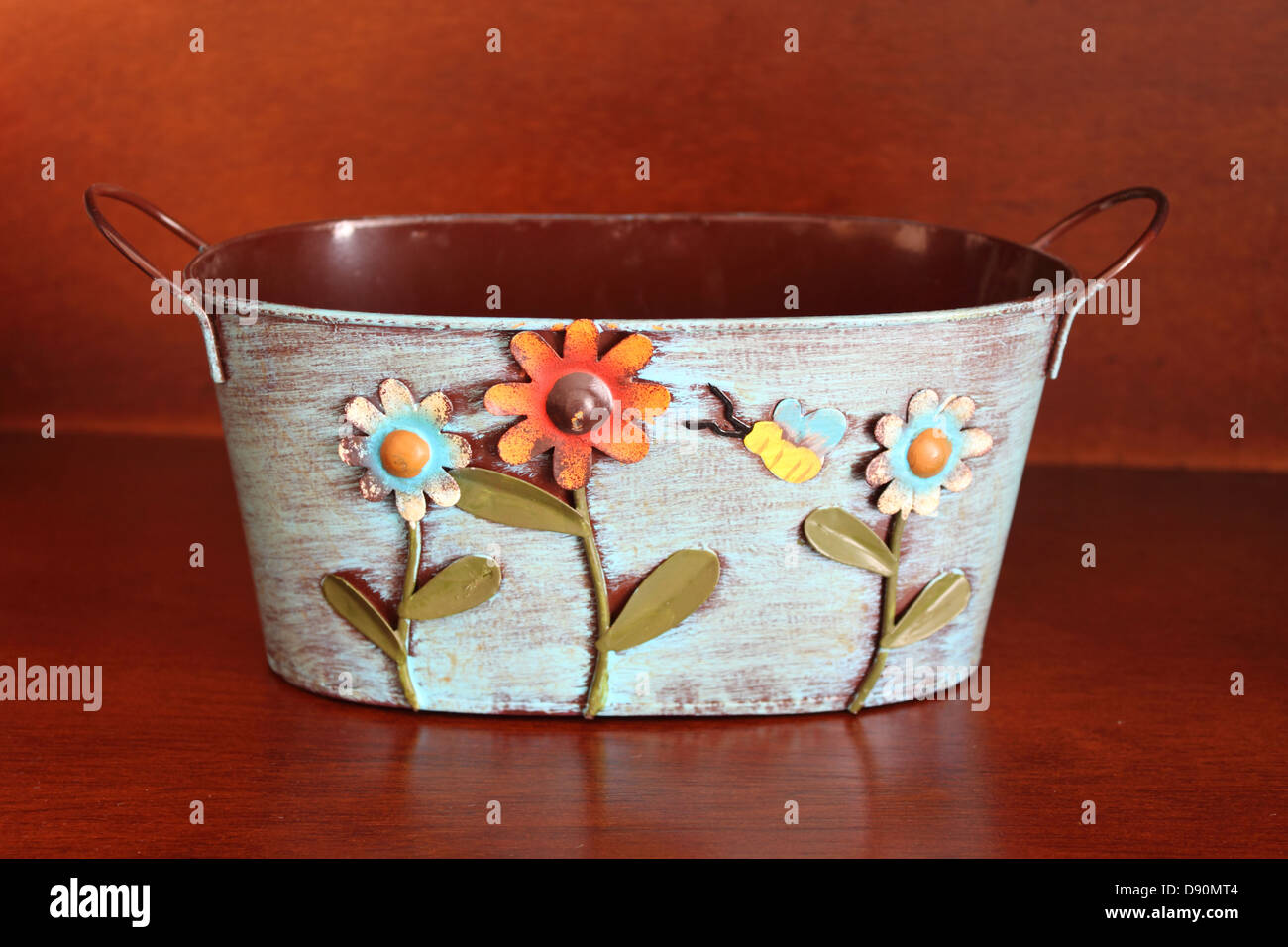 Decorated metal basket for flowers - Stock Image
