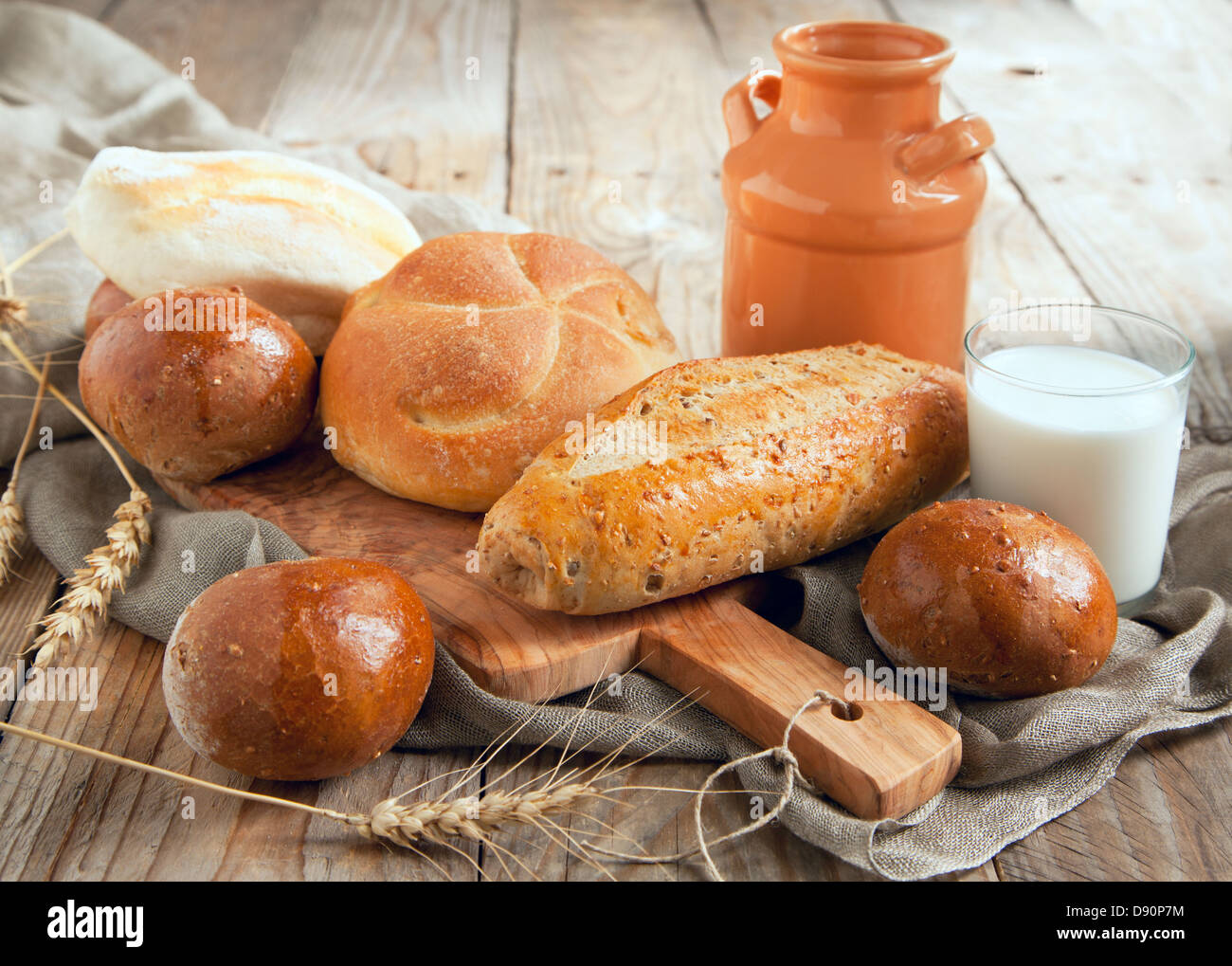 Bakery product assortment with bread loaves and buns - Stock Image