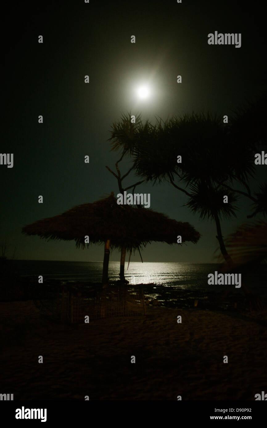Full moon over beach - Stock Image