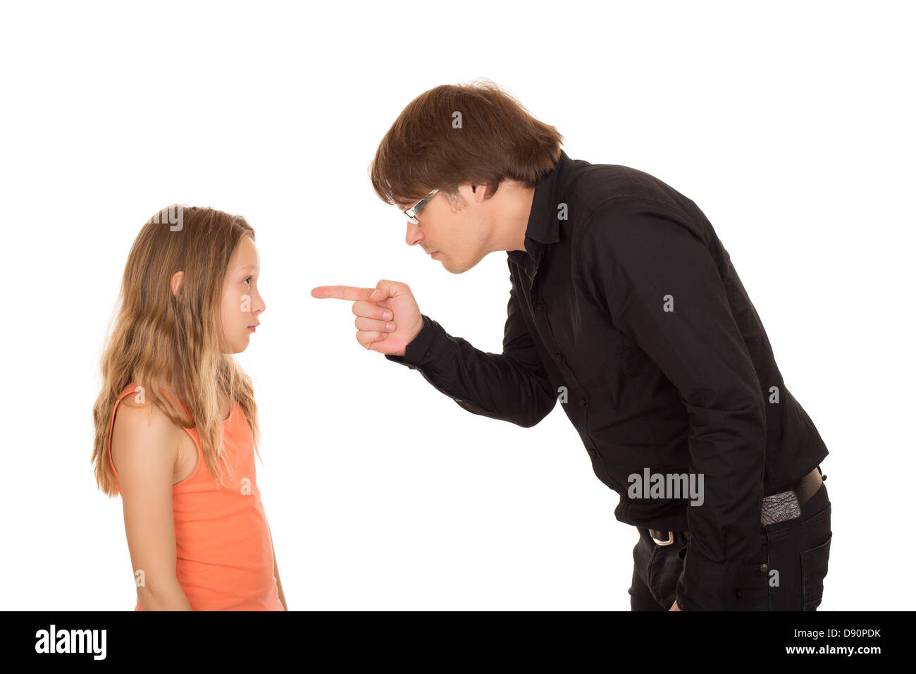 Angry father pointing the finger and explains what's wrong to her daughter. Isolated on white background. - Stock Image
