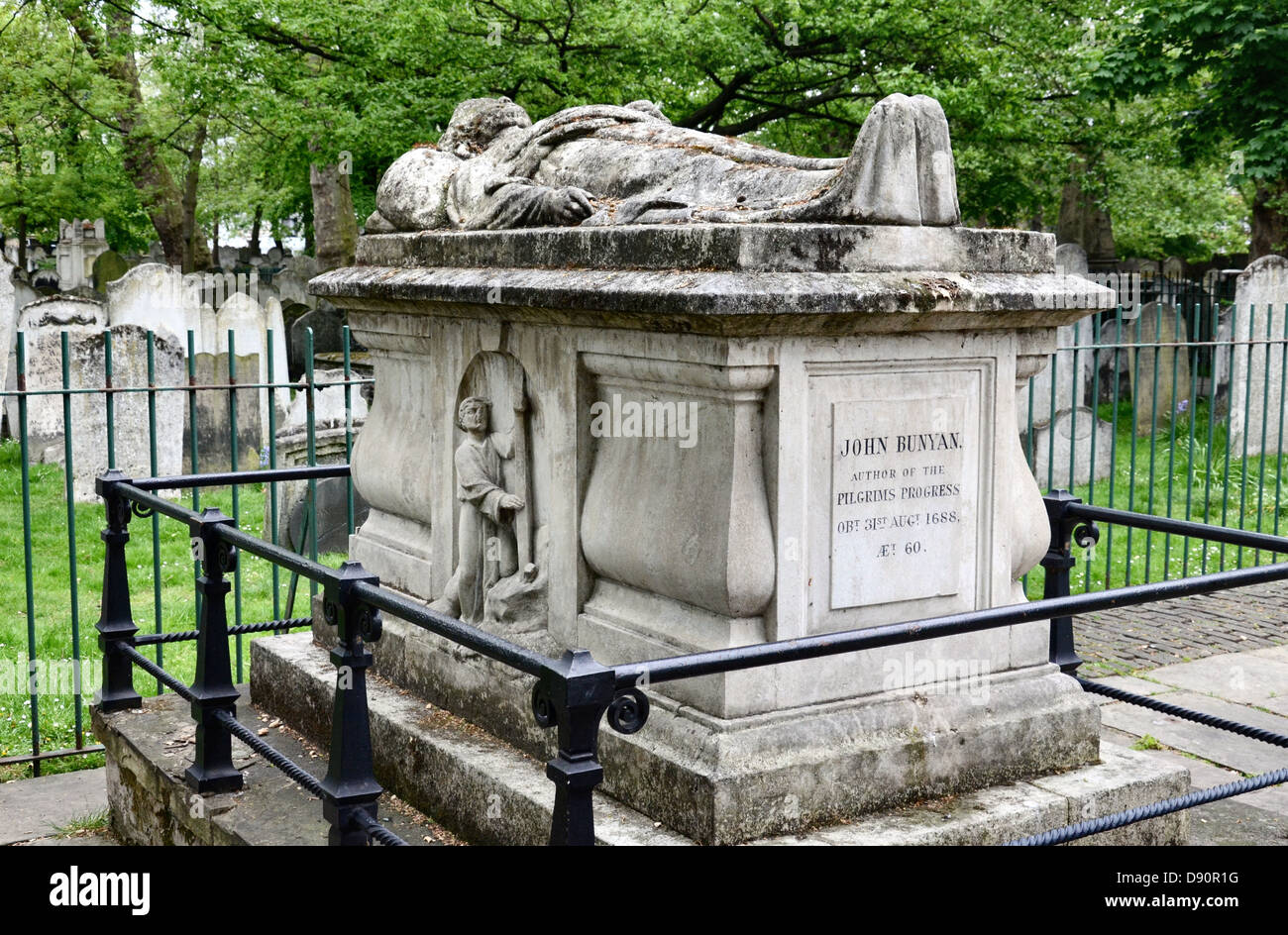 The grave of John Bunyan (1628-1688) in Bunhill Fields Burial ground, Islington, London. - Stock Image