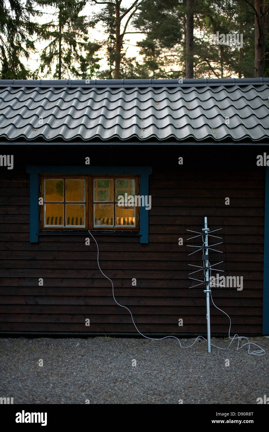 Digital television aerial outside a cottage, Sweden. - Stock Image