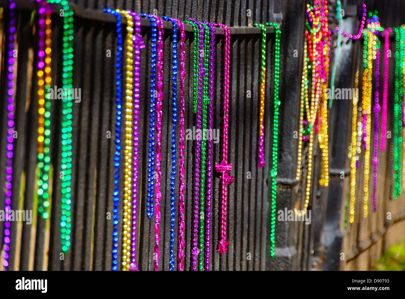 Beads on a fence after Mardi Gras in New Oleans, LA Stock Photo