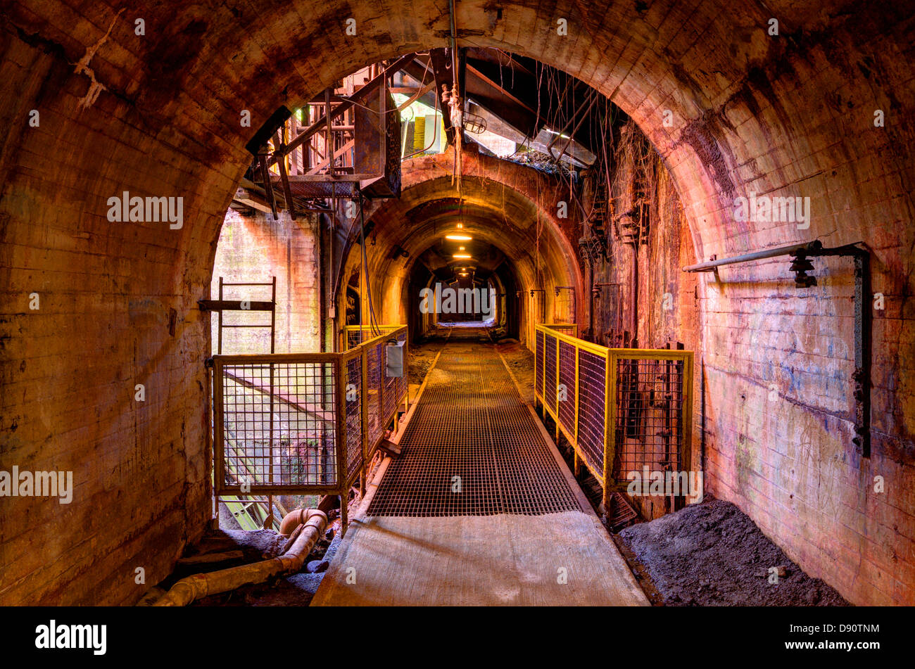 Factory tunnel with dramatic grittiness. - Stock Image