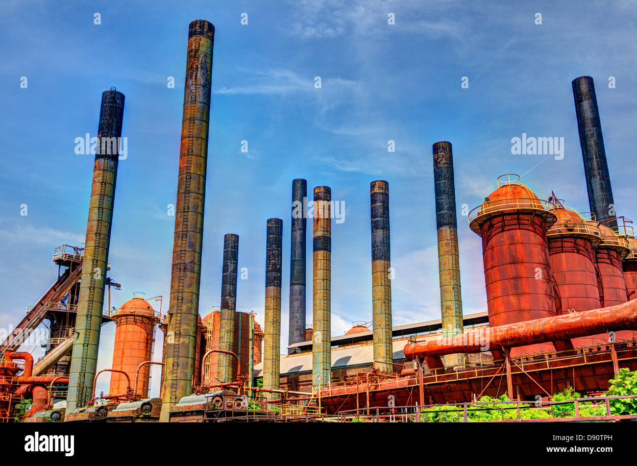 Smoke stacks of an old factory. - Stock Image